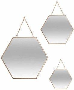 decoracion con espejos hexagonales